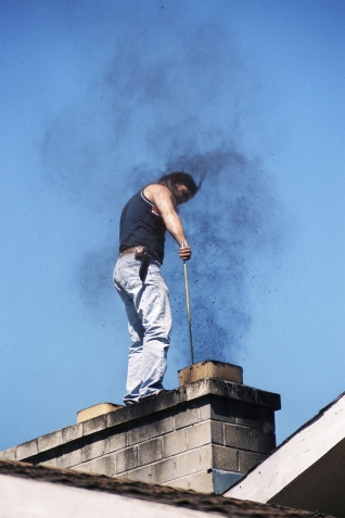 Man cleaning chimney