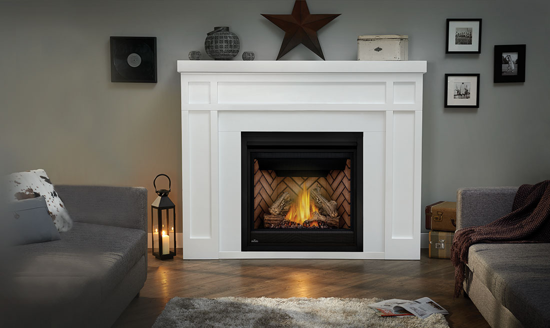 The Empire gas fireplace mantel offers a bold statement with clean and simple design elements that allow the beauty of the fireplace to glow.