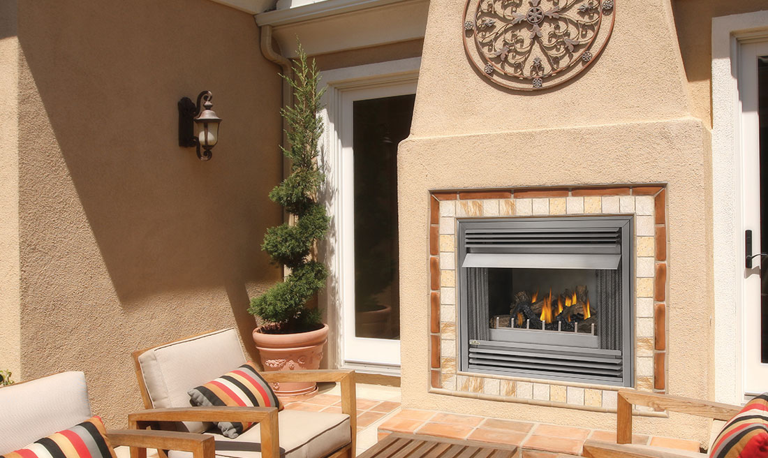 The Napoleon Riverside 36 Outdoor Gas Fireplace features PHAZER log set
