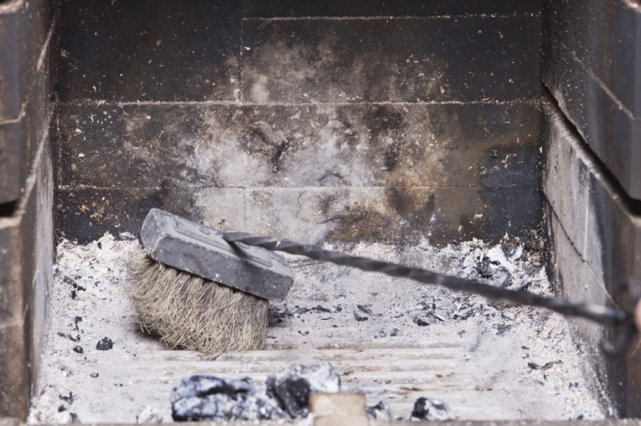 Wood ash removal via a chimney sweep