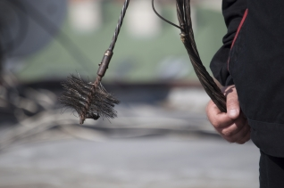 Hand Holding A Chimney Sweeping Brush